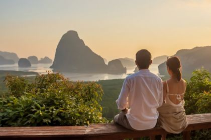 1280 couple traveler enjoy Phang Nga bay view point shutterstock 1945171033